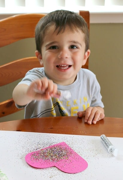 Toddlers love sprinkling glitter on the glue!