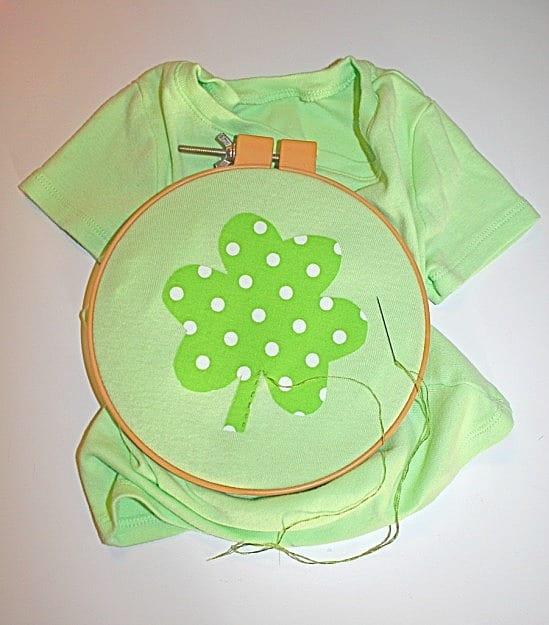 stitching shamrock onto shirt