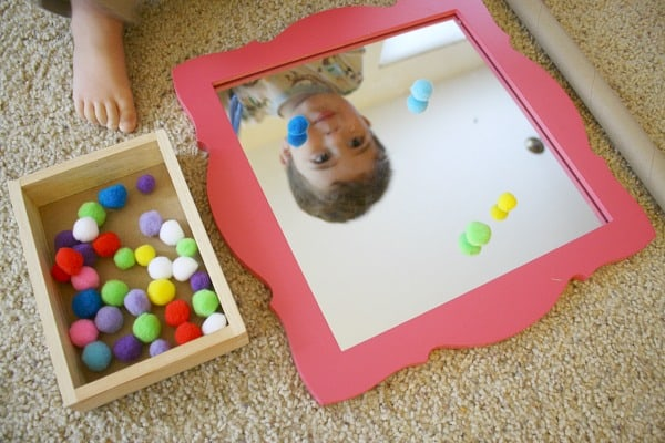Toddler Activities: Fine Motor Play with Pompoms, Tweezers, and a Mirror