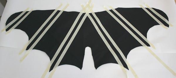 Masking tape lines on bat wings