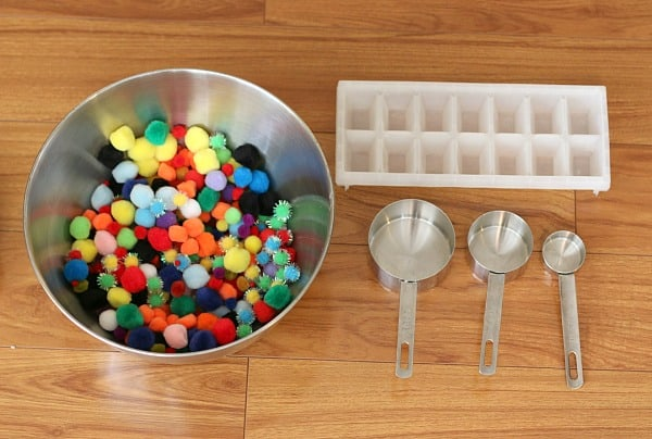 Toddler Activities: Scooping Pom Poms (Such a great way to practice fine motor skills, color words, and basic math skills!)~ Buggy and Buddy