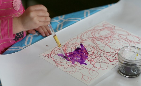 Painting over oil pastels with watercolors