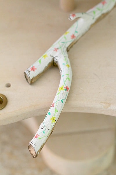 painted stick on nature table
