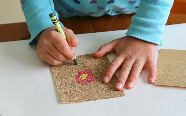 creating art with crayons and sandpaper