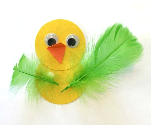 add feathers to paper bird craft for kids