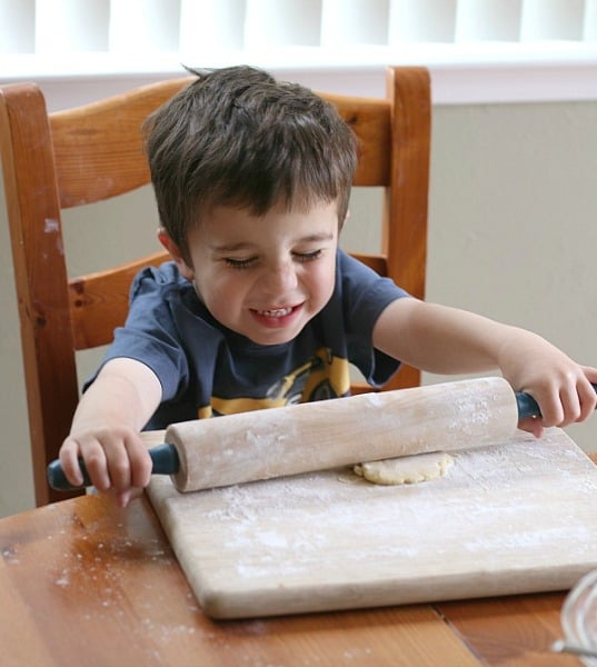 toddler making sugar cookies