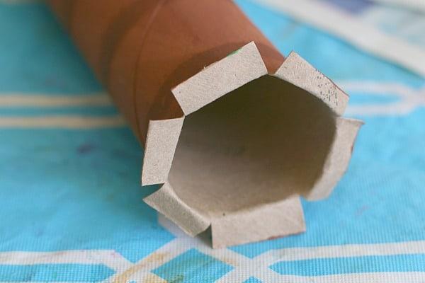 snip tabs in paper towel roll