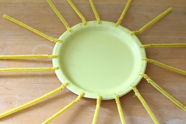 Twist pipe cleaners onto paper plate to create sun craft