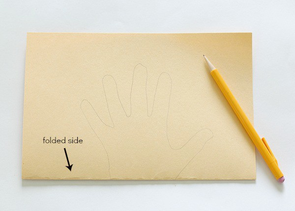 trace your hand on the folded paper