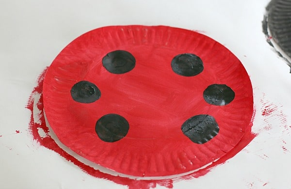 paint black circles onto the red plate