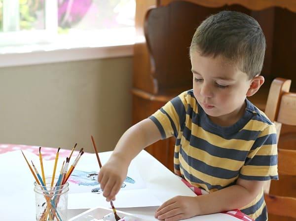 preschooler doing blotto art