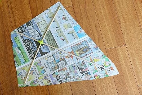 cut newspaper for kite
