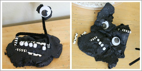 playing with black playdough and loose parts