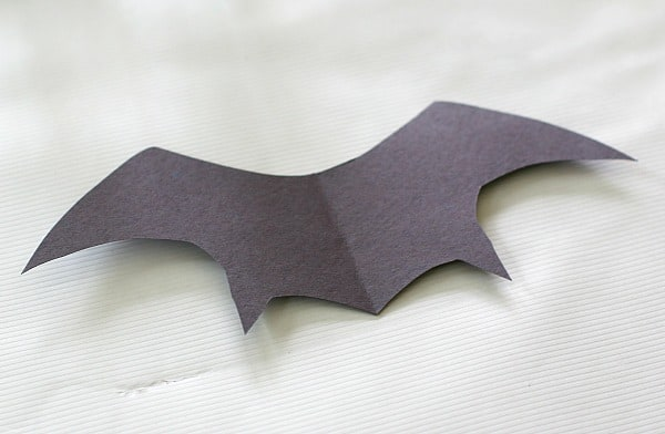 cut out bat wings from construction paper