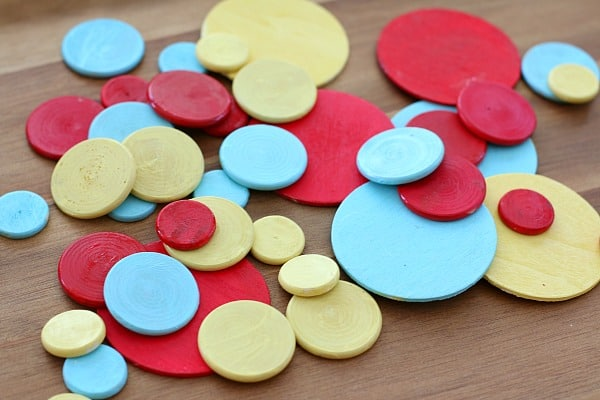 painted wooden circles for Press Here playdough activity