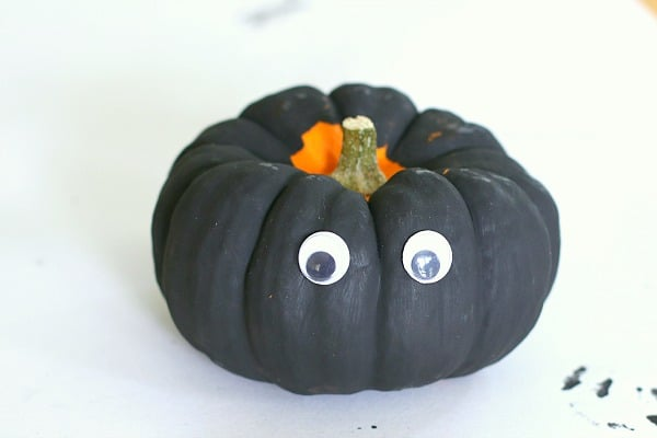 add googly eyes to your pumpkin