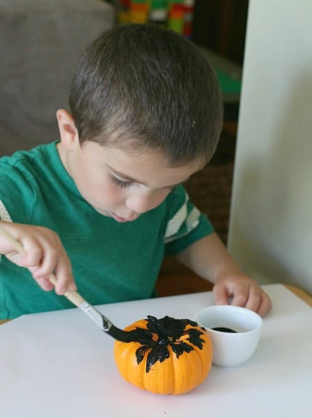 Paint your pumpkin with black paint.