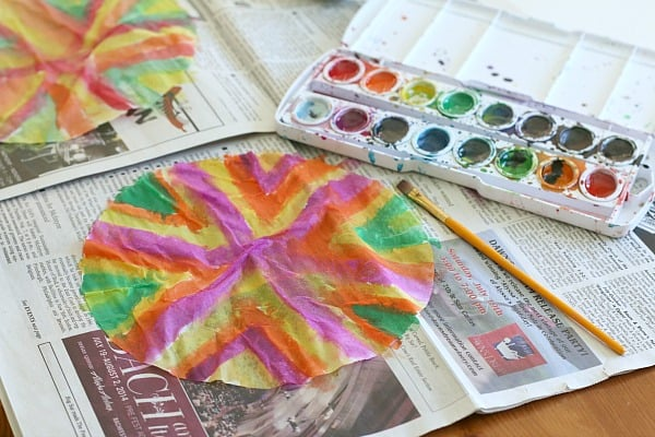 painting the coffee filter for turkey craft for kids