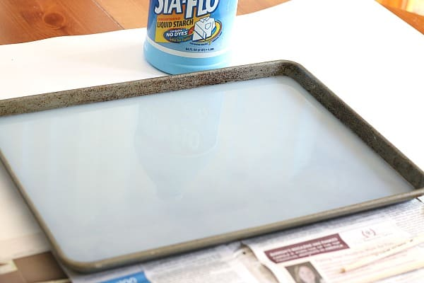 pour a layer of liquid starch into the cookie sheet
