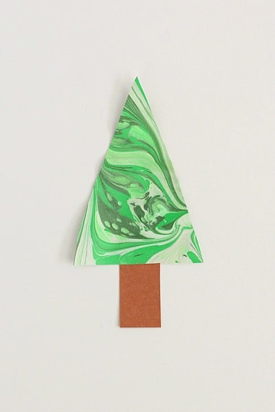 add a brown trunk to your marbled Christmas tree craft for kids