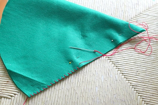 use a whip stitch to sew up the seam in your felt elf hat