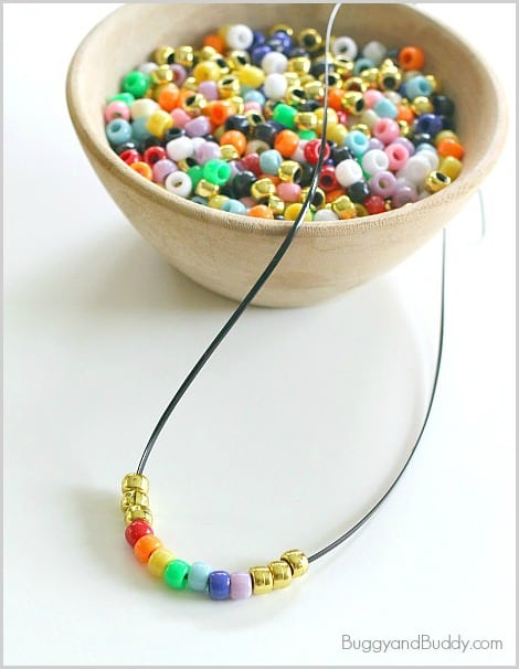 St. Patrick's Day Craft for Kids: Beaded Rainbow Necklace~ BuggyandBuddy.com