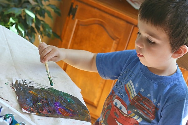 painting on newspaper with preschoolers