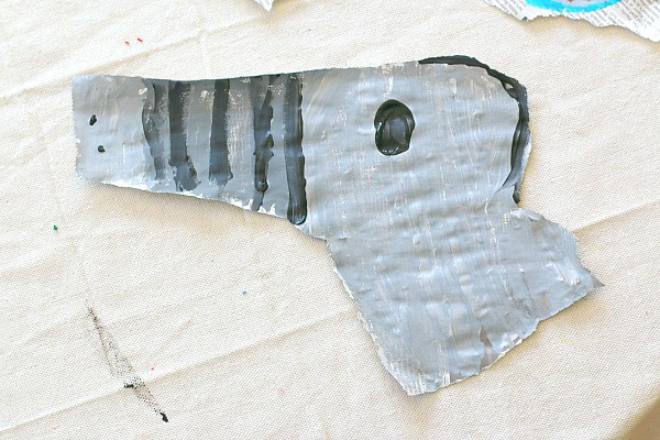 painting on torn newspaper
