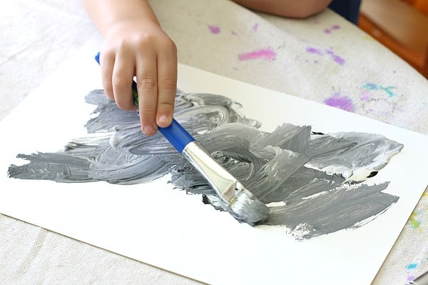 mixing black and white paint to make gray