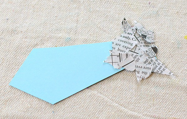 glue the torn newspaper onto your bookmark
