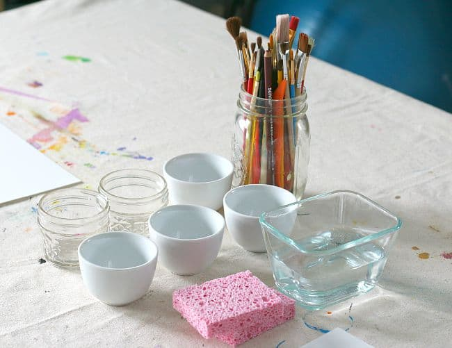 materials for painting with watercolors and plastic wrap