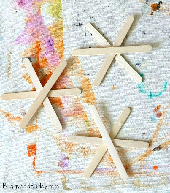 glue together three popsicle sticks to make your spiderwebs