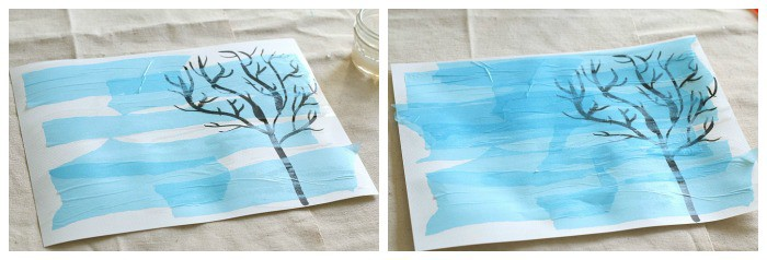 use liquid starch to adhere light blue tissue paper to your winter art