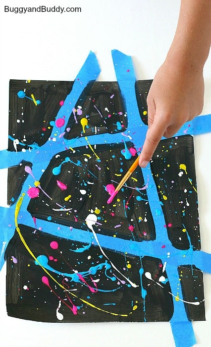 splatter paint over your painted paper