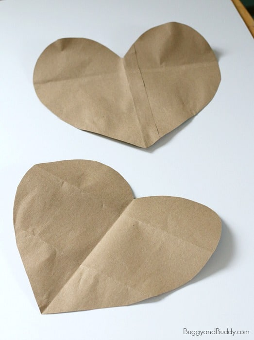 cut out two large hearts from a large brown paper bag