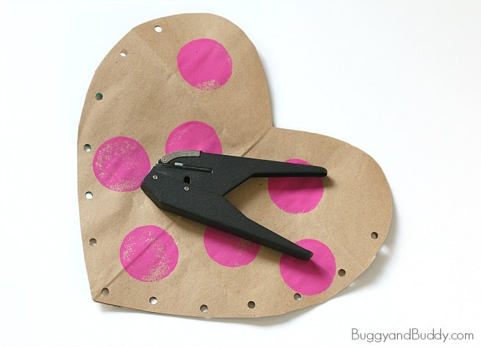punch holes around your paper heart with a single hole punch
