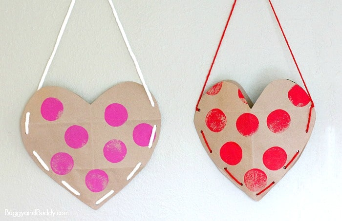 Heart Valentine Holder made from an old brown paper grocery bag! (We decorated our with sponge stamping and laced up the sides!) ~ BuggyandBuddy.com