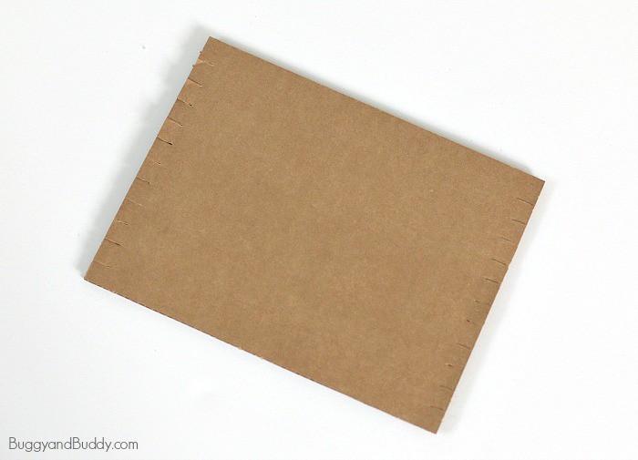 cut slits along your cardboard weaving loom