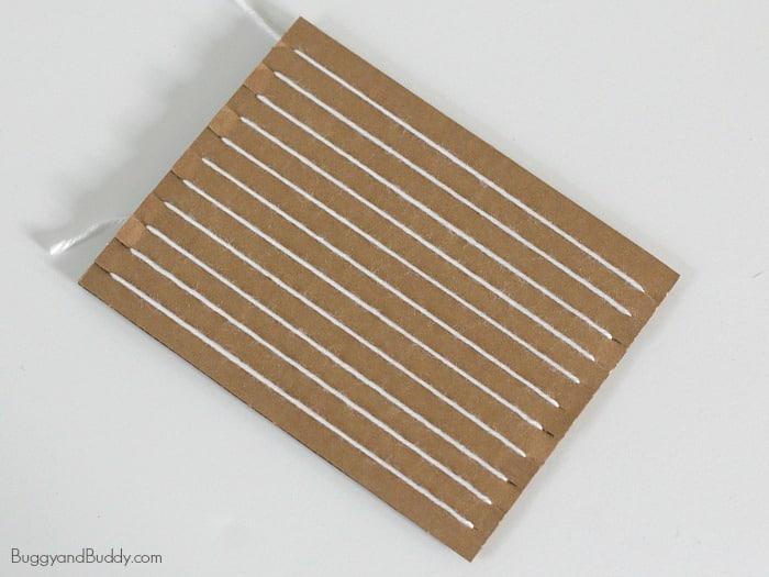 string your cardboard loom with yarn