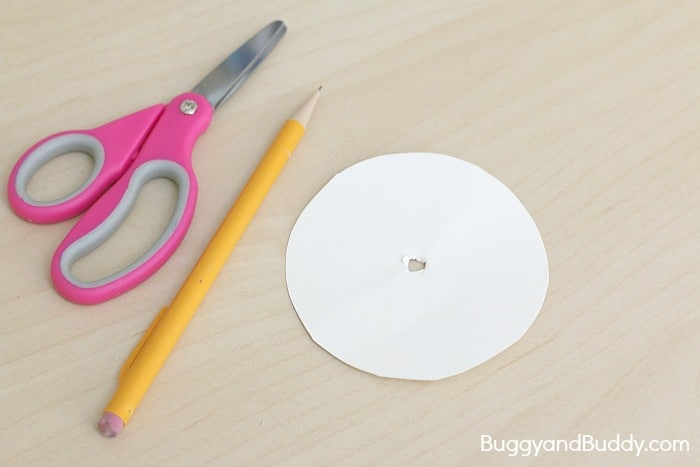 poke a hole in your paper circle