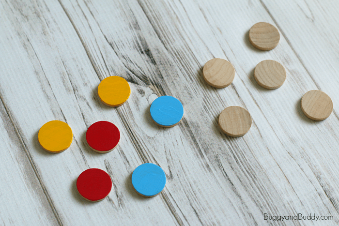 paint wooden circles for the magnet activity