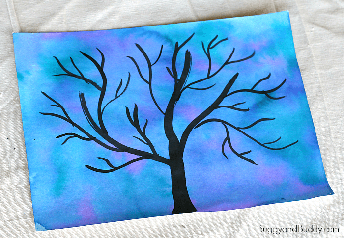 paint a black tree silhouette over the watercolor background