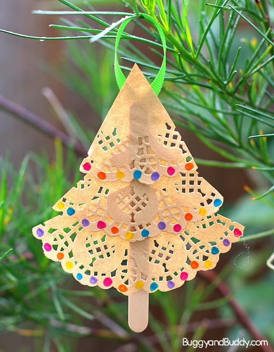 homemade christmas ornament craft for kids using paper doilies and popsicle sticks