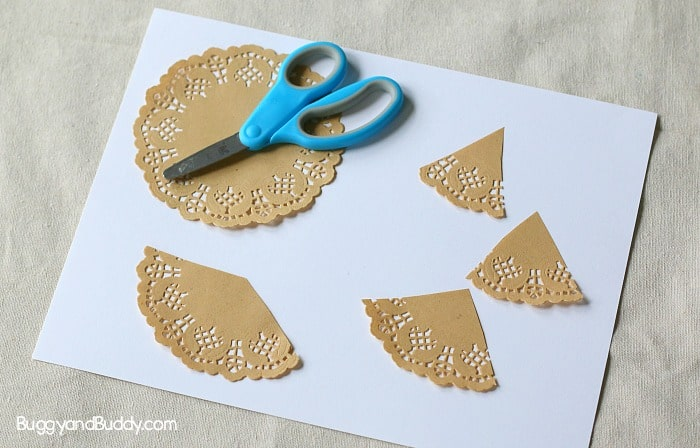 cut your paper doily for your christmas tree craft