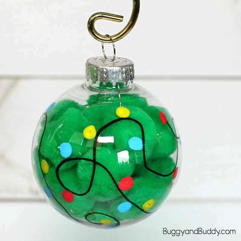 Christmas Light Ornament Craft for Kids Using pom poms - Christmas Light Ornament Craft For Kids - Buggy And Buddy