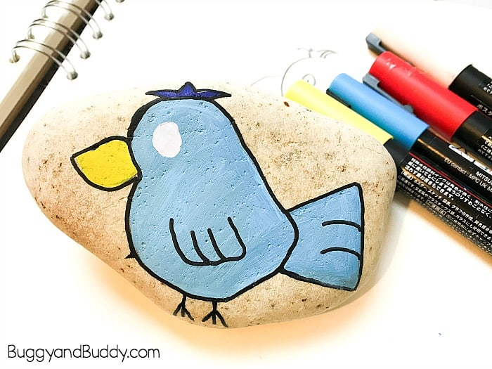 paint an eye onto your painted bird rock or stone