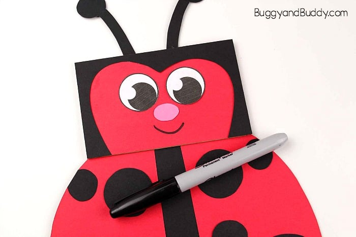 add a nose and mouth to your ladybug paper bag puppet craft for kids