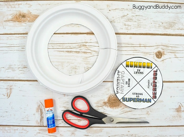 glue the second superhero template to another paper plate and cut it out