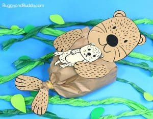 sea otter paper bag craft for kids with baby sea otter and tissue paper kelp, includes free sea otter template printable