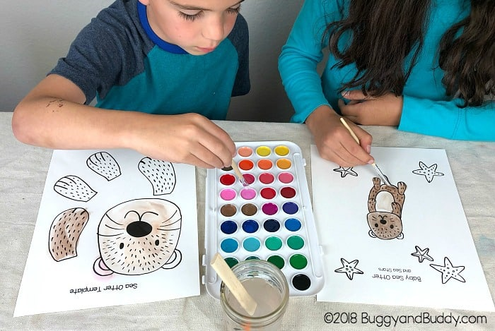 paint your sea otter template with watercolor paint